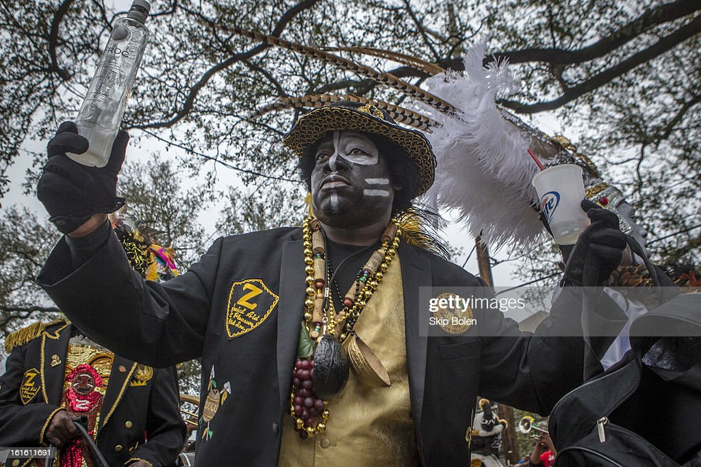 A member of the Zulu Social Aid & Pleasure Club prepares to march in the 'Zulu Parade' on Jackson Avenue, the first parade on the morning of 2013 Mardi Gras on February 12, 2013 in New Orleans, Louisiana.