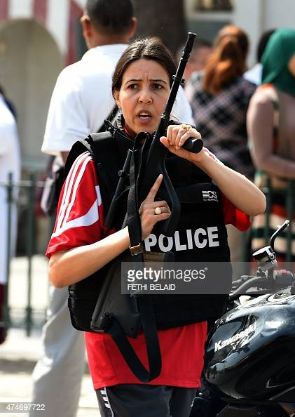 A member of Tunisian special forces stands guard outside the Bouchoucha army barracks in Tunis on May 25 2015 after a soldier opened fire at his...