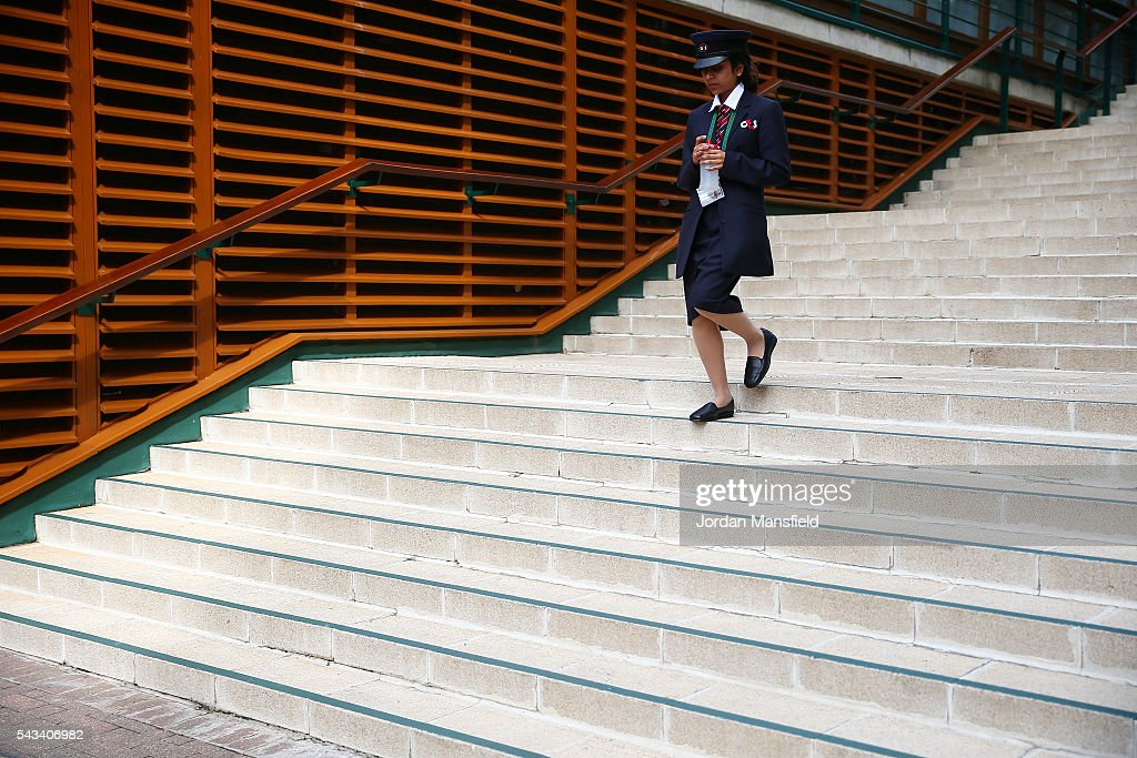 A member off staff walks on during day two of the Wimbledon Lawn Tennis Championships at the All England Lawn Tennis and Croquet Club on June 28, 2016 in London, England.