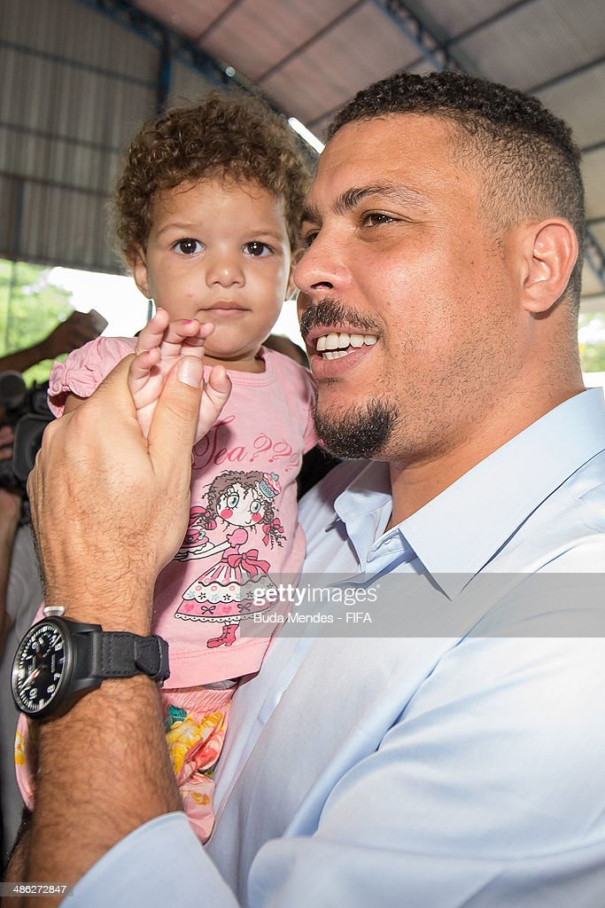 LOC Member Ronaldo Luis Nazario greets a kid during visit the FIFA 11 for Health Program as part of the 2014 FIFA World Cup Host City Tour on April 23, 2014 in Cuiaba, Brazil