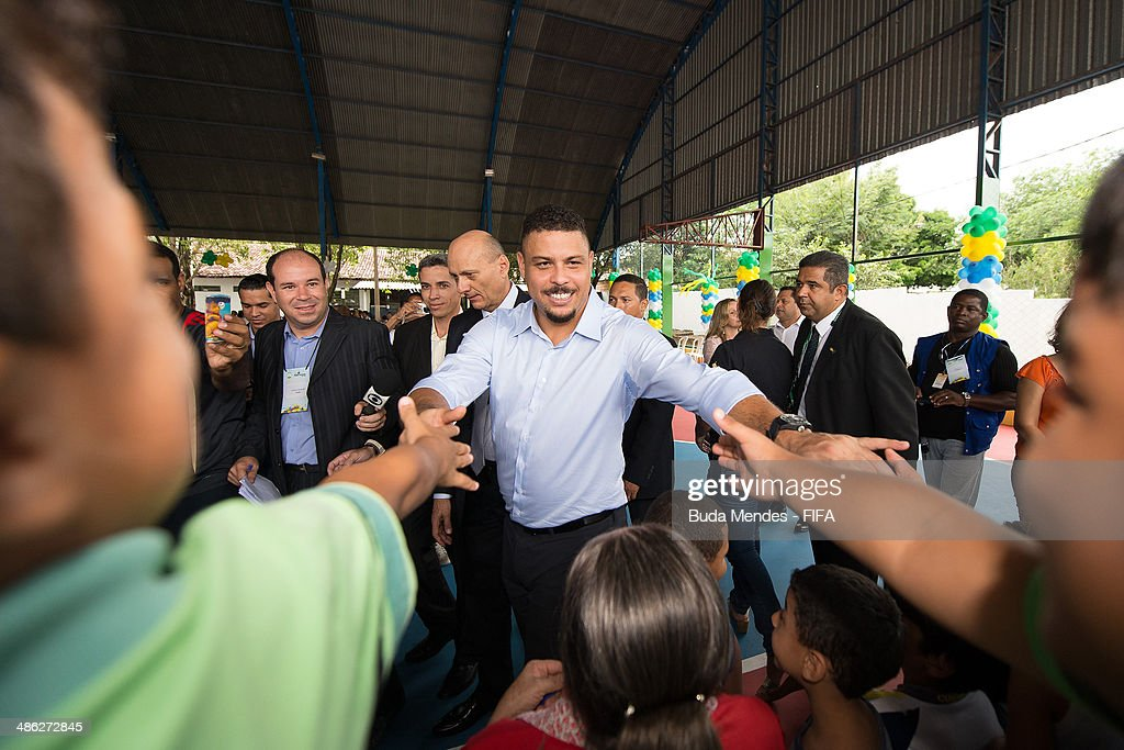 LOC Member Ronaldo Luis Nazario (C) greets the kids during visit the FIFA 11 for Health Program as part of the 2014 FIFA World Cup Host City Tour on April 23, 2014 in Cuiaba, Brazil