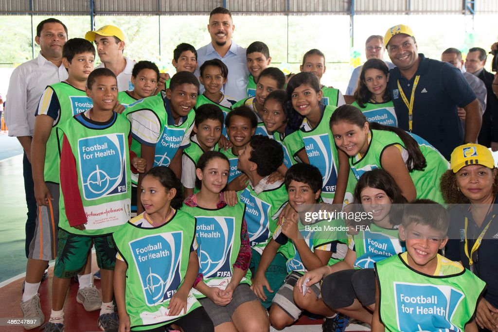 LOC Member Ronaldo Luis Nazario (C) poses for photo with kids during visit the FIFA 11 for Health Program as part of the 2014 FIFA World Cup Host City Tour on April 23, 2014 in Cuiaba, Brazil