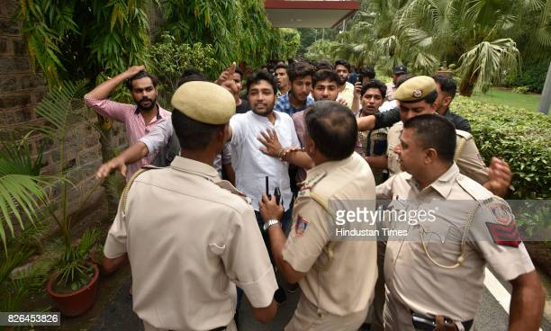 ABVP member shout slogans against AISA student march at Ramjas Collage during their march against the allegedly growing number of violent incidents...