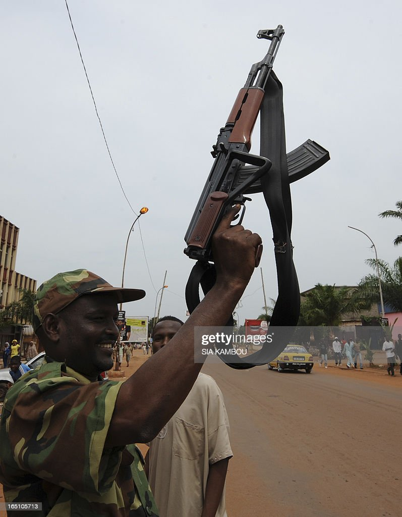 A member the rebel Seleka coalition poses with a kalashnikov automatic weapon during a support march fornew Central African Republic leader Michel Djotodia in the streets of Bangui on March 30, 2013. The Central African Republic's new strongman Michel Djotodia vowed Saturday not to contest 2016 polls and hand over power at the end of the three-year transition he declared after his coup a week ago.