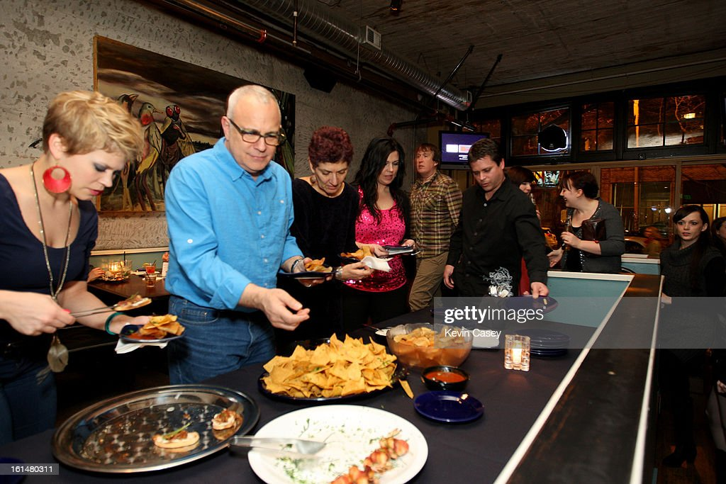 Members and guests of The Recording Academy enjoy the food at the Grammy telecast party at Spitfire on February 10, 2013 in Seattle, Washington.
