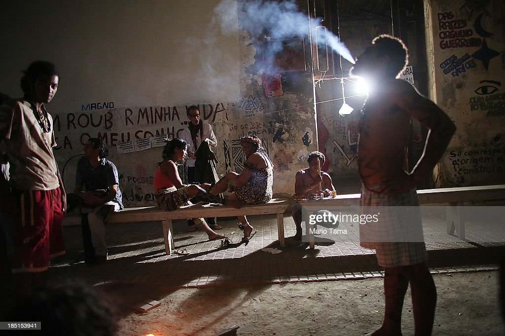 Members and supporters of an indigenous community gather in the Aldeia Maracana building they are occupying next to Maracana Stadium, the site of the 2014 World Cup final, on October 17, 2013 in Rio de Janeiro, Brazil. The fading structure used to house the Museum of Indian Culture before deteriorating and becoming occupied by squatting indigenous members in 2006. The building was slated for destruction ahead of the 2014 World Cup and the community was forcibly evicted in March. However, the community has managed to return and thus far have successfully battled to save the structure, which they hope to convert into an indigenous university. Indigenous groups throughout Brazil are battling the Brazilian government over land rights and other issues.