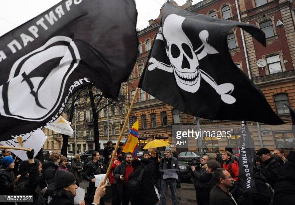 Members and supporters of anticopyright Pirate Party take part in a rally against what they call the censorship in the Internet in SaintPetersburg on...