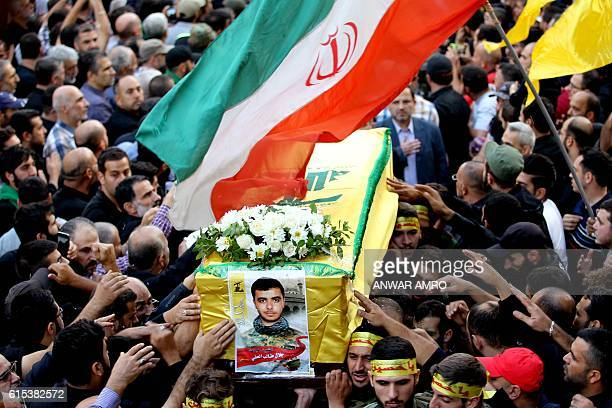 Members and supporters of Lebanon's Shiite Muslim movement Hezbollah carry the coffin of Hezbollah's militant Jalal alEffeh who was killed in combat...