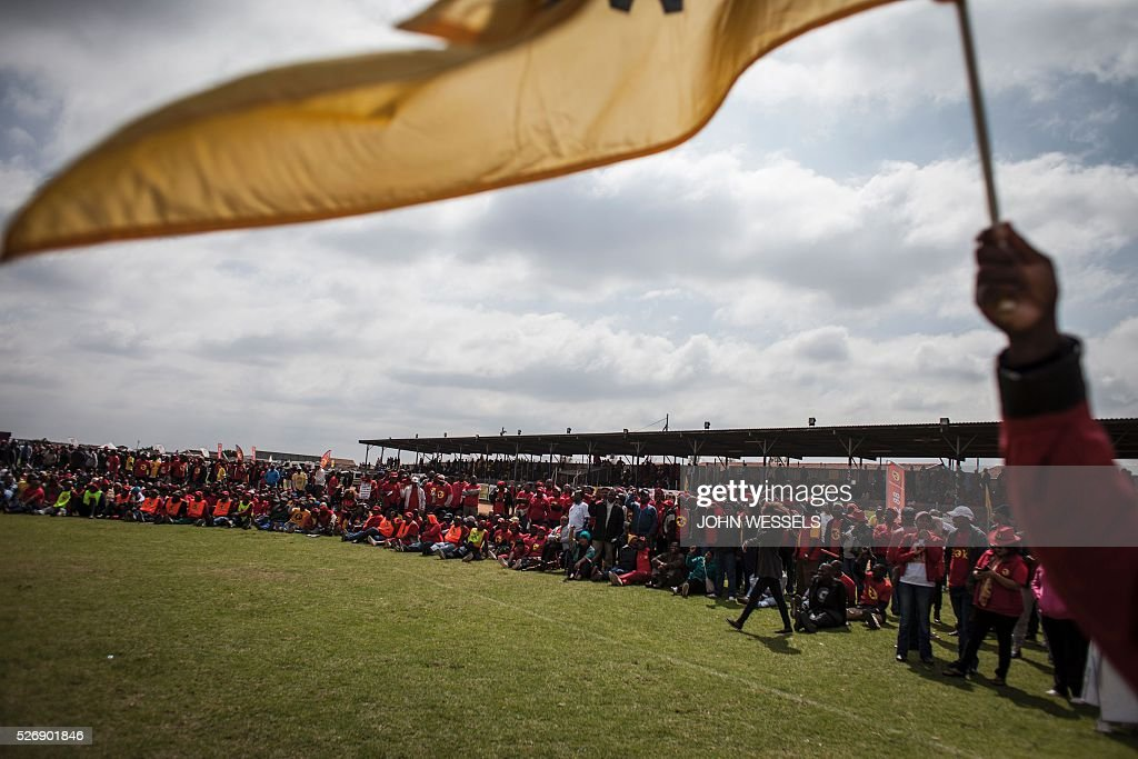 Members and supporters of National Union of Metalworkers of South Africa (NUMSA), one of the biggest South African unions that was expelled from the main South African Trade Unions Federation (COSATU), gather during a May Day rally organized by a new United Front South African labour movement at Tembisa stadium on May 1, 2016 in Tembisa. Vavi was expelled from Cosatu in March 2015 for bringing it into disrepute and causing divisions by speaking out against the ANC governments policies and saying it had failed workers. He had since launched a new union federation to rival Cosatu. / AFP / JOHN