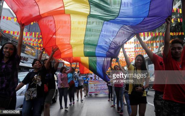 Members and supporters of the lesbian gay bisexual transgender community take part in a parade in Manila on December 13 2014 The LGBT annual pride...