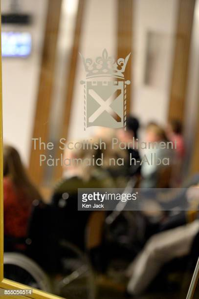 Members and supporters of theScottish Mesh Survivors group listen to evidence on transvaginal mesh implants on the public benches at the Scottish...