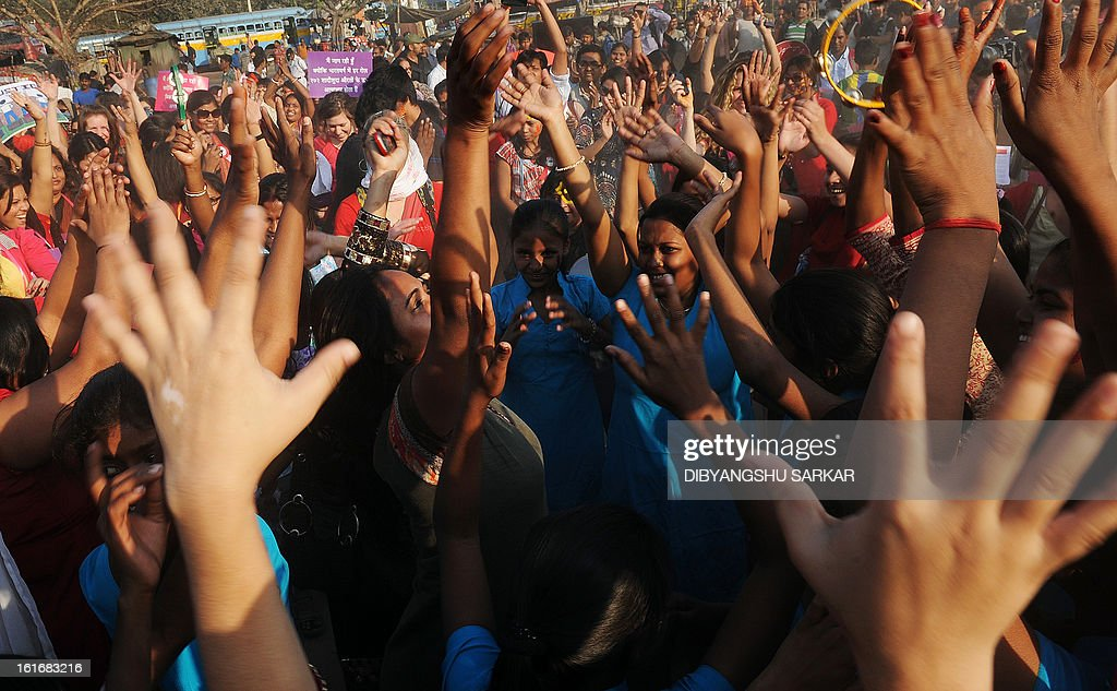 Members and supporters of various sexual minority groups dance during a protest meeting against all forms of physical and mental violence against women and girls all over the world, in Kolkata on February 14, 2013. Indians were at the forefront of global protests on Thursday in the One Billion Rising campaign for women's rights, galvanised by the recent fatal gangrape that shocked the country. AFP PHOTO/Dibyangshu SARKAR