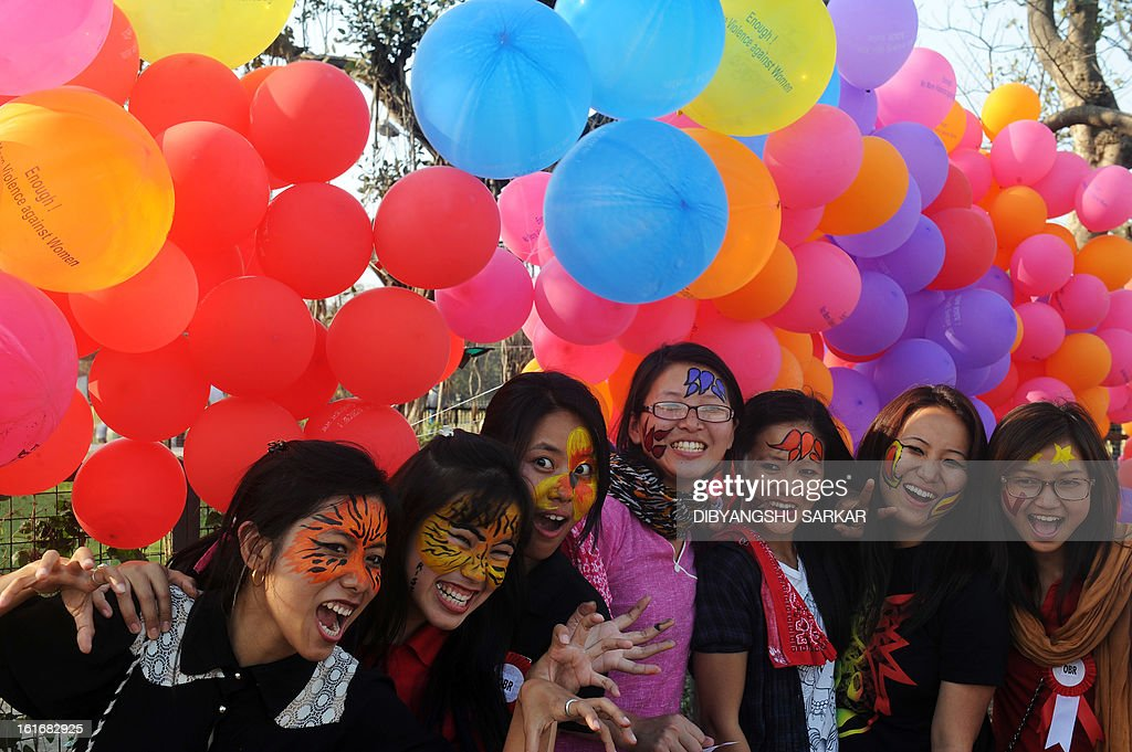 Members and supporters of various sexual minority groups enjoy a moment during a protest meeting against all forms of physical and mental violence against women and girls all over the world, in Kolkata on February 14, 2013. Indians were at the forefront of global protests on Thursday in the One Billion Rising campaign for women's rights, galvanised by the recent fatal gangrape that shocked the country. AFP PHOTO/Dibyangshu SARKAR