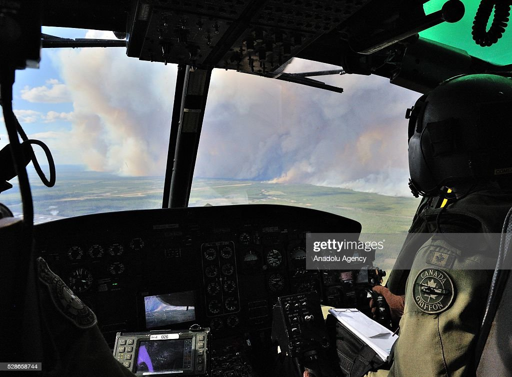 Members from 408 Tactical Helicopter Squadron, Edmonton fly a CH-146 Griffon to view the damage created by wild fires in the Fort McMurray area on May 5, 2016.The Canadian Armed Forces have air assets deployed in support of the Province of Alberta's wildfire emergency response efforts.