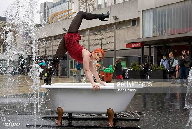 Members From A New Variety Night Show Of Circus Acts And Cabaret Sets Called 'Soap' Perform For The Public In Bathtubs In Lyric Square In Hammersmith...