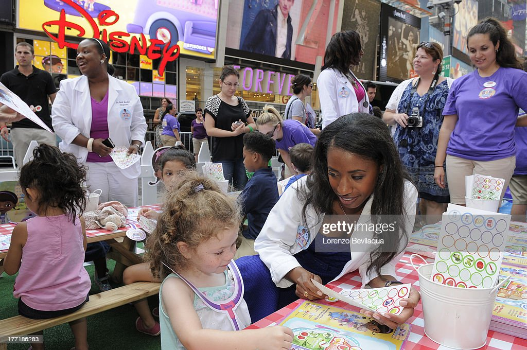 DOC MCSTUFFINS - Members from Artemis Medical Society, an organization of more than 2500 female African-American physicians from around the world who formed their group after seeing a reflection of themselves in the main character of Disney Junior's 'Doc McStuffins,' were on-hand Wednesday, August 21 when The Doc Mobile, an interactive-health focused tour based on the acclaimed series, made a stop in front of New York's Time Square Disney Store. FAMILIES