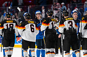 Members from both Team Finland and Team Germany shake hands in a preliminary round game during the 2015 IIHF World Junior Hockey Championships at the...