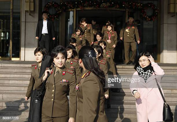 Members from North Korea's Moranbong band walk out of their hotel in Beijing on December 11 2015 North Korea's premier pop group the allgirl...