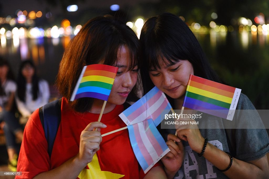 Members from the local lesbian gay bisexual and transgender community gather to celebrate a law newly approved by the National Assembly on...