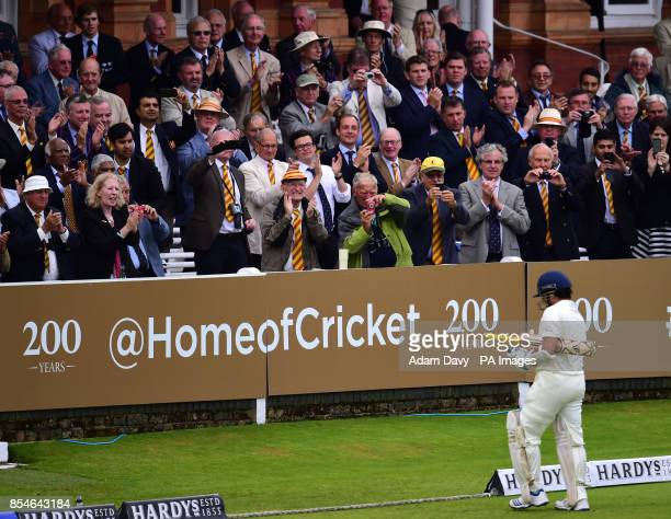 Members in the pavillion applaud MCC's Sachin Tendulkar during the Lord's Bicentenary match at Lord's Cricket Ground London