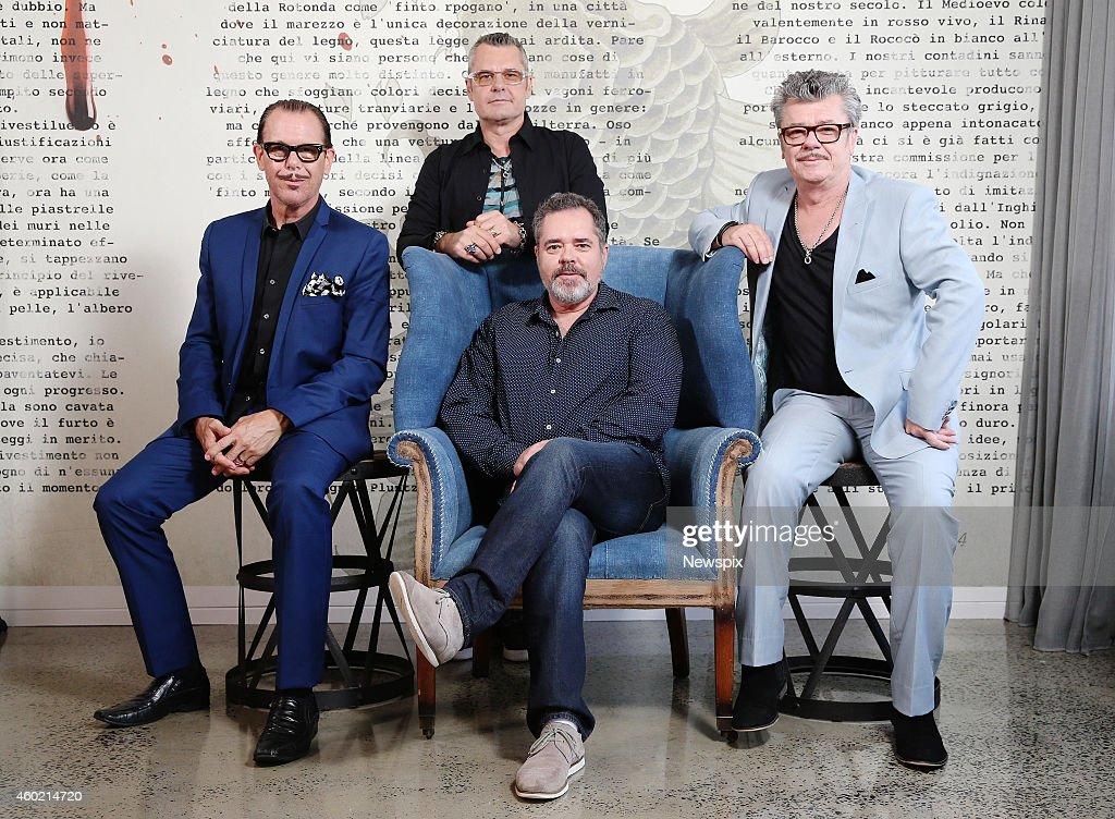 'INXS' members Kirk Pengilly, Jon Farris, Andrew Farris and Tim Farris pose at Universal Music Woolloomooloo on December 5, 2014 in Sydney, Australia.