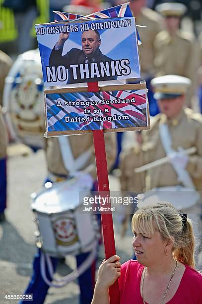 Members march alongside Orangemen and women march during a pro union parade less than a week before voters go to the polls in a yes or no referendum...