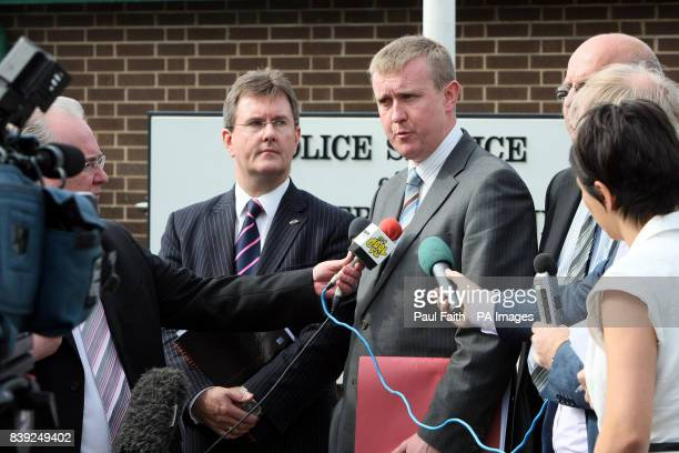 DUP Members Mervyn Storey and Jeffrey Donaldson MP speak to the media after their meeting at PSNI headquarters in Belfast