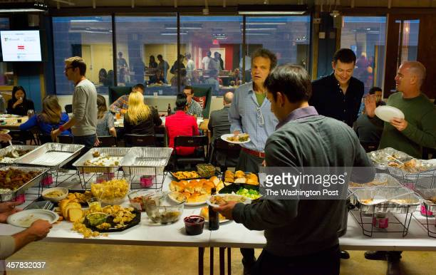 Members of 1776 gathered for a Thanksgiving family style meal on November 22 2013 in Washington DC 1776 is a business incubator that provides counsel...