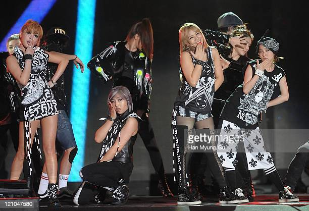 Members of 2NE1 perform onstage during the Incheon Korean Wave Festival 2011 at Incheon World Cup Stadium on August 13 2011 in Incheon South Korea