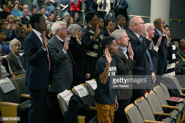 Members of a 16 member Ferguson Commission are sworn in by Missouri Governor Jay Nixon on November 18 2014 in St Louis Missouri The 16 member...