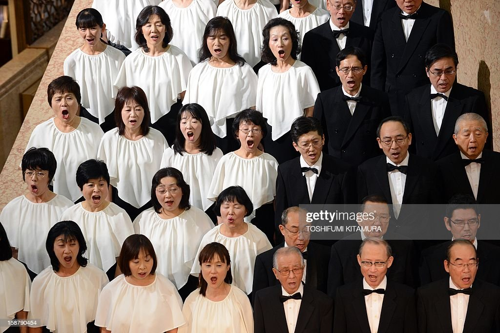 Members of a 178-member choir group sing Ludwig van Beethoven's Symphony No. 9 at a department store in central Tokyo on December 29, 2012. The 29th annual New Year's concert is held to attract year-end shoppers to the store. AFP PHOTO / TOSHIFUMI KITAMURA