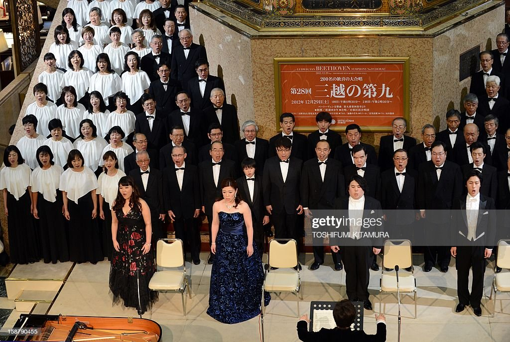 Members of a 178-member choir group sing Ludwig van Beethoven's Symphony No. 9 at a department store in central Tokyo on December 29, 2012. The 29th annual New Year's concert is held to attract year-end shoppers to the store.