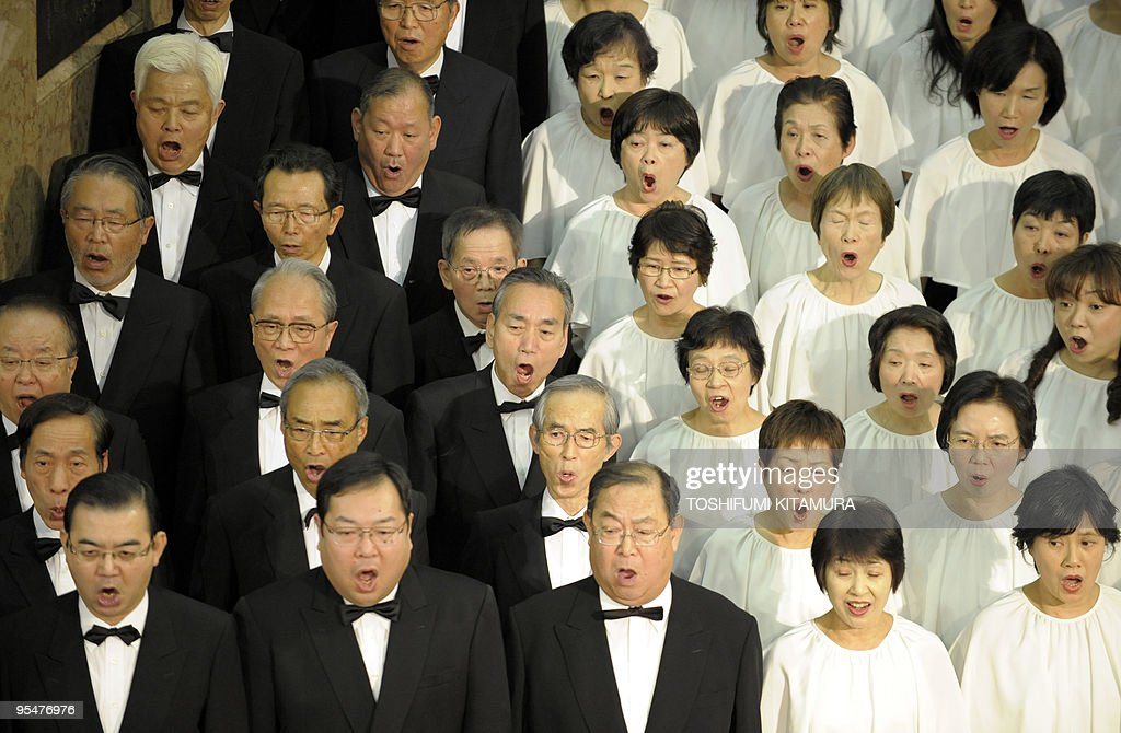 Members of a 223-member chorus group and four soloists perform Ludwig Van Beethoven's Symphony No.9 'Choral' during the 25th annual year-end concert at Mitsukoshi department store in the Nihombashi area of Tokyo on December 29, 2009. More than 500 year-end shoppers enjoyed listening to the music, a tradition at this time of the year before the New Year holiday, one of the biggest holiday periods of the year in Japan. AFP PHOTO / TOSHIFUMI KITAMURA