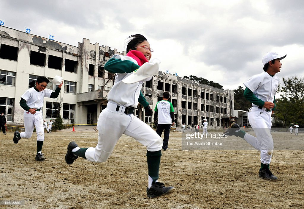 Members of a baseball club attend a training session at Kadonowaki Elementary School on November 11, 2012 in Ishinomaki, Miyagi, Japapn. The school building were destroyed by fire caused by the tsunami, but most of pupils and teachers evacuated to the hill before the tsunami reached, resulted in only seven fatalities. Japan marks 20 months anniversary of the Great East Japan earthquake and following tsunami, occurred on March 11, 2011.