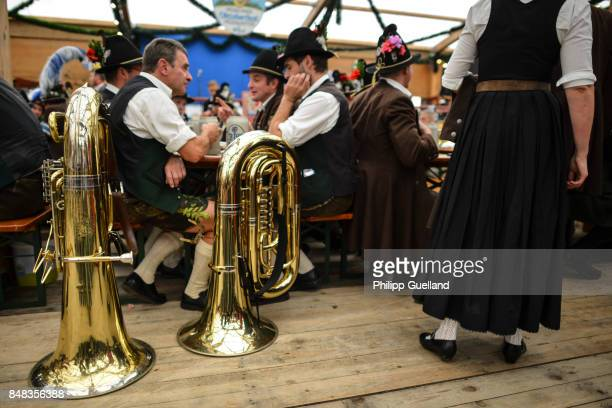 Members of a bavarian marching band sit next to their tubas in the 'Tradition' tent on the second day of the 2017 Oktoberfest beer fest on September...