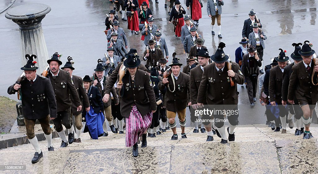 Members of a Bavarian riflemen's association arrive for the traditional 'Boellerschiessen' (firing of a salute with a special gun) on the last day of Oktoberfest beer festival on October 7, 2012 in Munich, Germany. The 'Boellerschiessen' officially signifies the closing of this year's edition of the world's biggest beer festival.