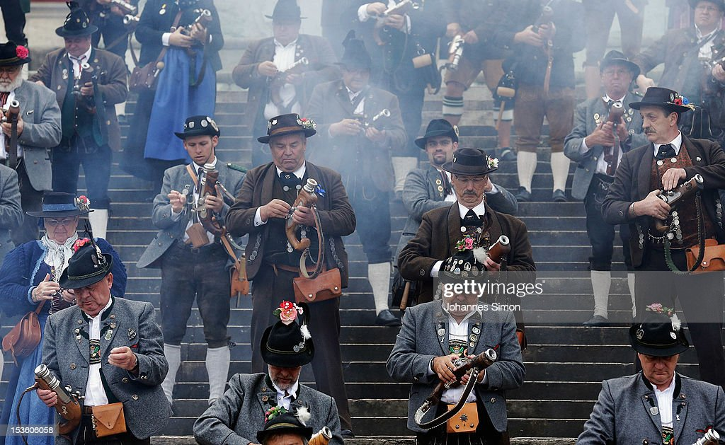 Members of a Bavarian riflemen's association charge their guns ahead of the traditional 'Boellerschiessen' (firing of a salute with a special gun) on the last day of Oktoberfest beer festival on October 7, 2012 in Munich, Germany. The 'Boellerschiessen' officially signifies the closing of this year's edition of the world's biggest beer festival.