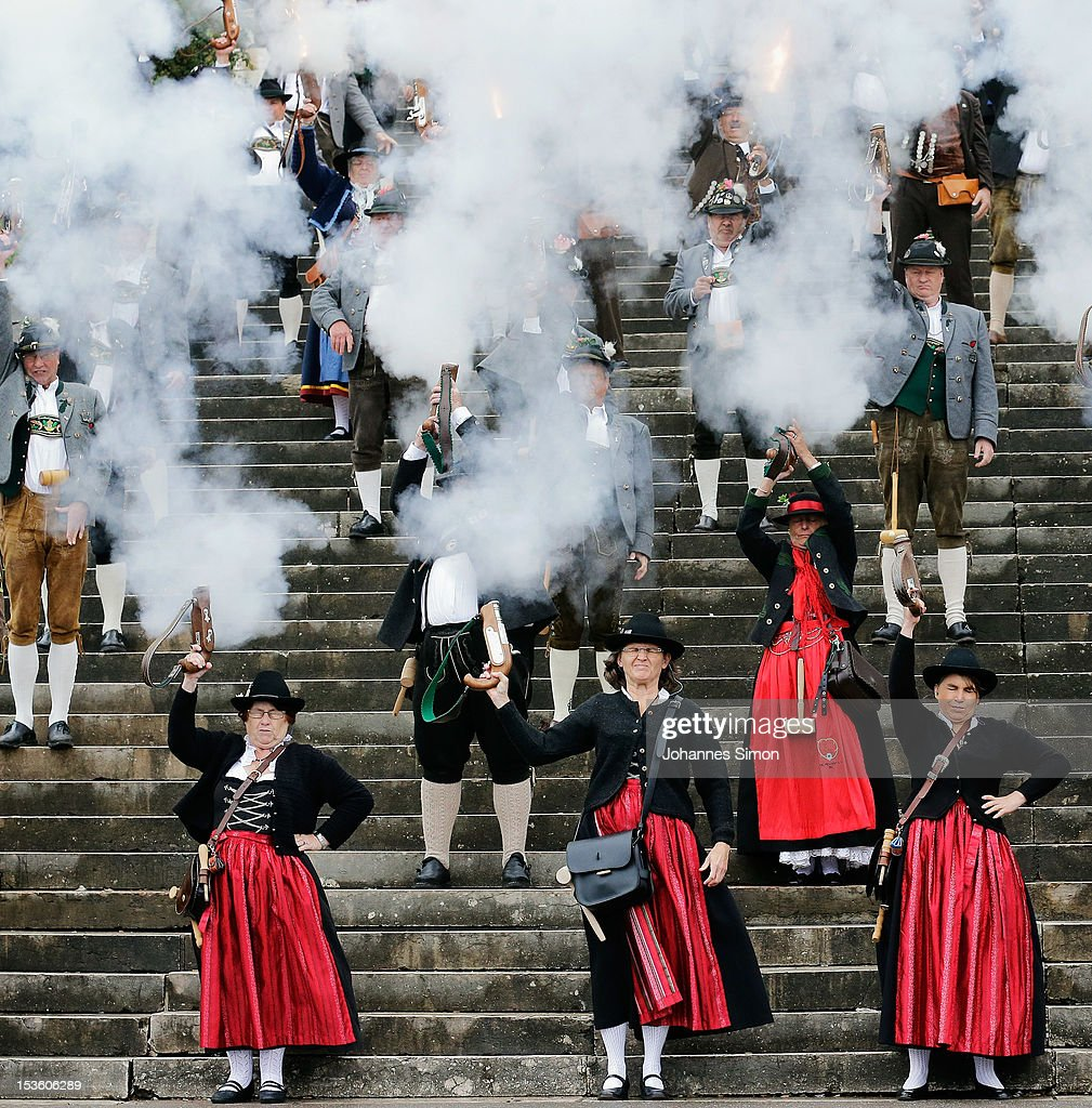Members of a Bavarian riflemen's association fire a shoot during the traditional 'Boellerschiessen' (firing of a salute with a special gun) on the last day of Oktoberfest beer festival on October 7, 2012 in Munich, Germany. The 'Boellerschiessen' officially signifies the closing of this year's edition of the world's biggest beer festival.