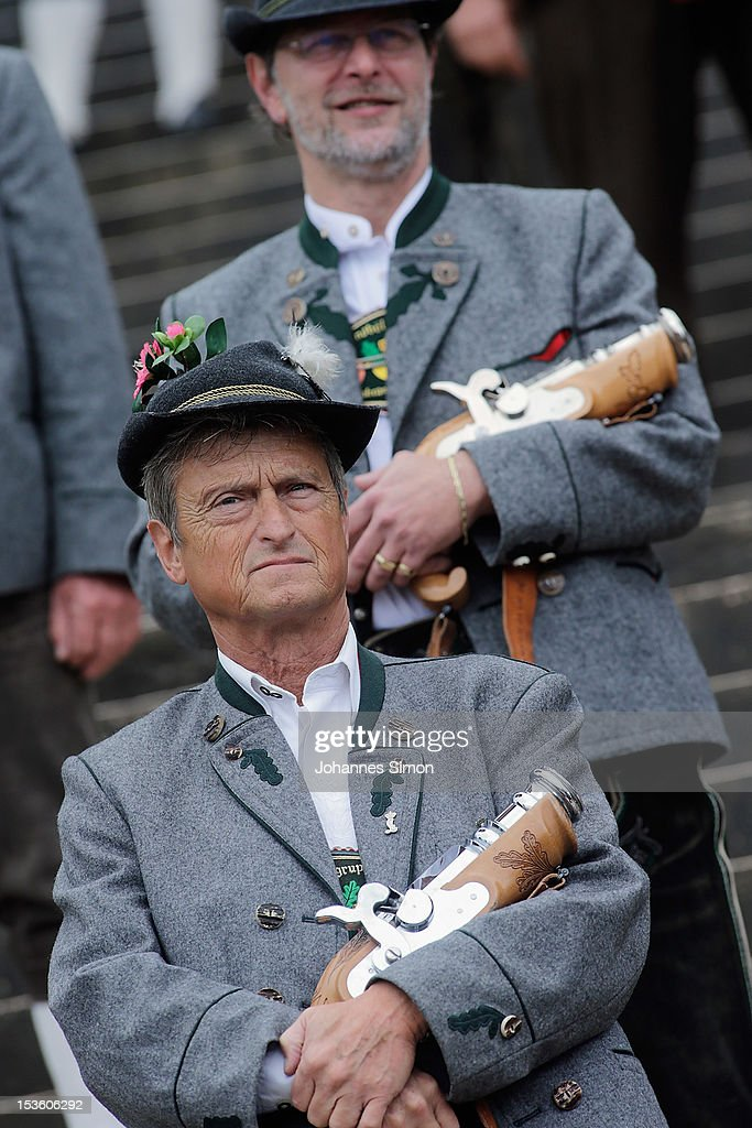 Members of a Bavarian riflemen's association wait for the beginning of the traditional 'Boellerschiessen' (firing of a salute with a special gun) on the last day of Oktoberfest beer festival on October 7, 2012 in Munich, Germany. The 'Boellerschiessen' officially signifies the closing of this year's edition of the world's biggest beer festival.