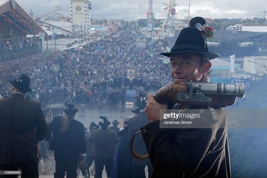 Members of a Bavarian riflemen's association wait for the shooting signal during the traditional 'Boellerschiessen' (firing of a salute with a special gun) on the last day of Oktoberfest beer festival on October 7, 2012 in Munich, Germany. The 'Boellerschiessen' officially signifies the closing of this year's edition of the world's biggest beer festival.