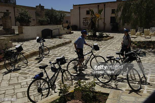 Members of a bicycle tour enjoy a breather at Masseria Monicelli a 400yearold fortified farm outside Lecce converted to an upscale bedandbreakfast