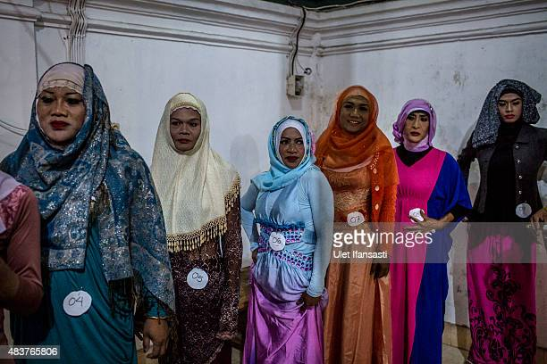Members of a boarding school AlFatah for transgender people known as 'waria' stand as prepare for their muslim fashion contest during Syawalan...