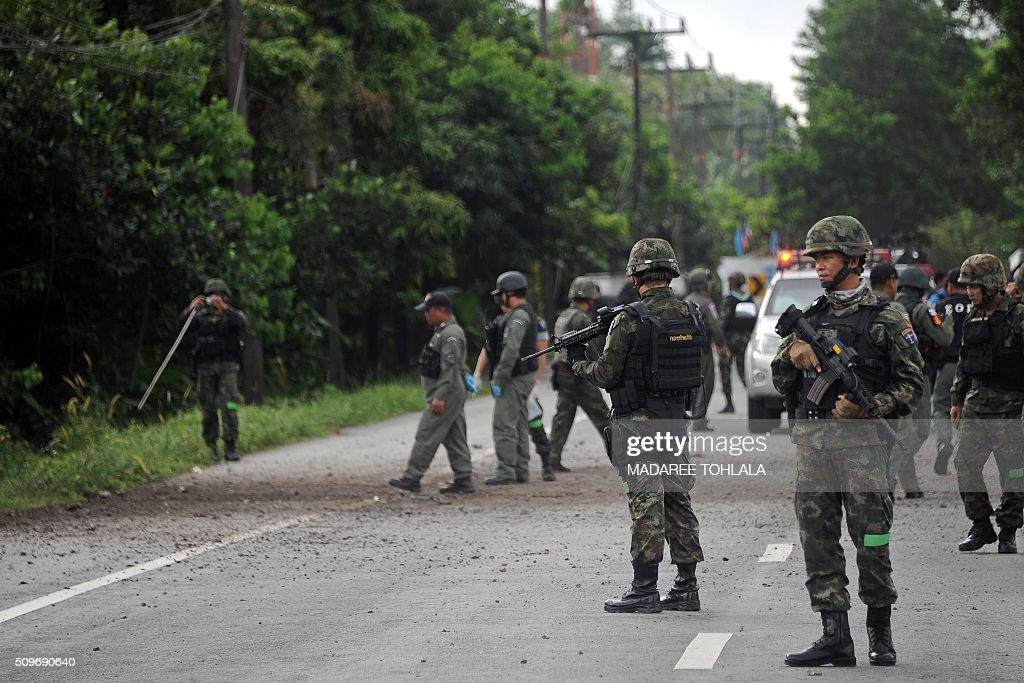 Members of a bomb squad unit inspect the scene following a blast from a roadside bomb planted by suspected separatist militants in the Bacho district of Thailand's restive southern province of Narathiwat on February 12, 2016. Militants in the Muslim-majority southernmost provinces, who are seeking greater autonomy from Thailand which annexed the region more than a century ago, have launched near-daily bomb attacks and shootings since 2004, targeting mostly security officers but also teachers and other civilians viewed as instruments of the Thai state. In total, more than 6,500 people -- mostly civilians -- have died in the unrest at the hands of both insurgents and security forces. AFP PHOTO / Madaree TOHLALA / AFP / MADAREE TOHLALA