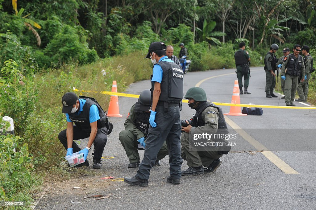 Members of a bomb squad unit inspect the scene following five roadside bomb blasts at four separate locations by suspected separatist militants in Bacho district in Thailand's restive southern province of Narathiwat on February 13, 2016. Militants in the Muslim-majority southernmost provinces, who are seeking greater autonomy from Thailand which annexed the region more than a century ago, have launched near-daily bomb attacks and shootings since 2004, targeting mostly security officers but also teachers and other civilians viewed as instruments of the Thai state. In total, more than 6,500 people -- mostly civilians -- have died in the unrest at the hands of both insurgents and security forces. AFP PHOTO / MADAREE TOHLALA / AFP / MADAREE TOHLALA