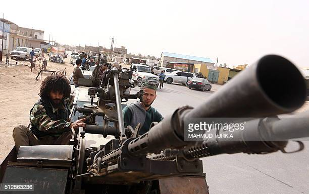 TOPSHOT Members of a brigade loyal to the Fajr Libya an alliance of Islamistbacked fighters drive pick up trucks mounted with machine guns during a...