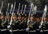 Members of a Chinese Army honour guard march before US Secretary of Defense Robert Gates arrives to review troops at a welcoming ceremony at Bayi...