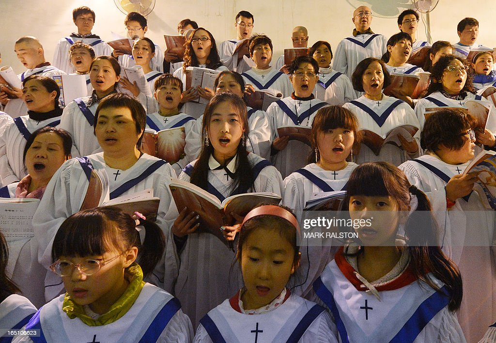 Members of a Chinese Catholic choir sing during an Easter service at the Cathedral of the Immaculate Conception in Beijing on March 30, 2013. Experts estimate that there are as many as 12 million Catholics in China, with about half in congregations under the officially-administered Chinese Catholic Patriotic Association. The rest belong to non-sanctioned or so-called underground churches. AFP PHOTO/Mark RALSTON