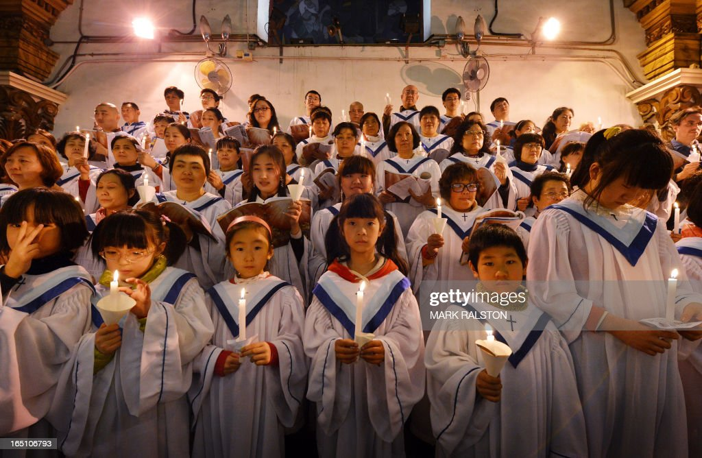 Members of a Chinese Catholic choir sing during an Easter service at the Cathedral of the Immaculate Conception in Beijing on March 30, 2013. Experts estimate that there are as many as 12 million Catholics in China, with about half in congregations under the officially-administered Chinese Catholic Patriotic Association. The rest belong to non-sanctioned or so-called underground churches.. AFP PHOTO/Mark RALSTON