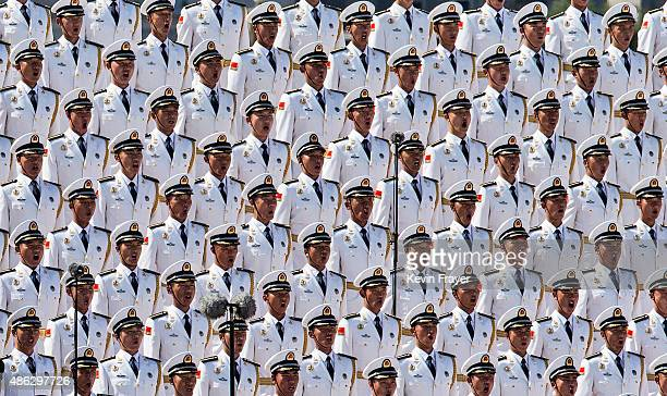 Members of a Chinese military choir sing near Tiananmen Square and the Forbidden City during a military parade on September 3 2015 in Beijing China...