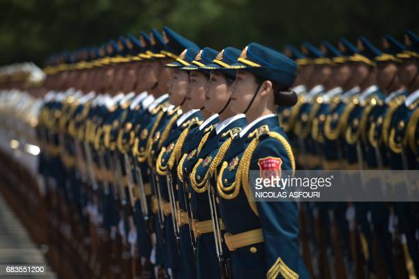 Members of a Chinese military honour guard prepare for a welcome ceremony for Cambodia's Prime Minister Hun Sen outside the Great Hall of the People...